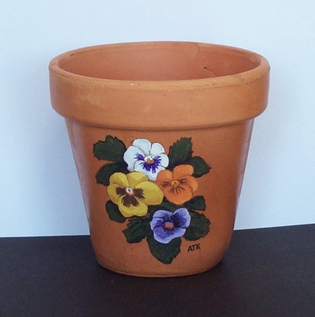 This 4 inch clay pot would look wonderful with your own pansies fresh or silk.