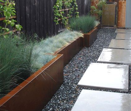 An almost instant solution to planting in a passageway is to use trough containers such as these. They take little space but help to breathe life into what could be a sterile environment.The use of grasses makes for an almost maintenance-free planting scheme, and also brings movement into the passageway as they move in the air currents.