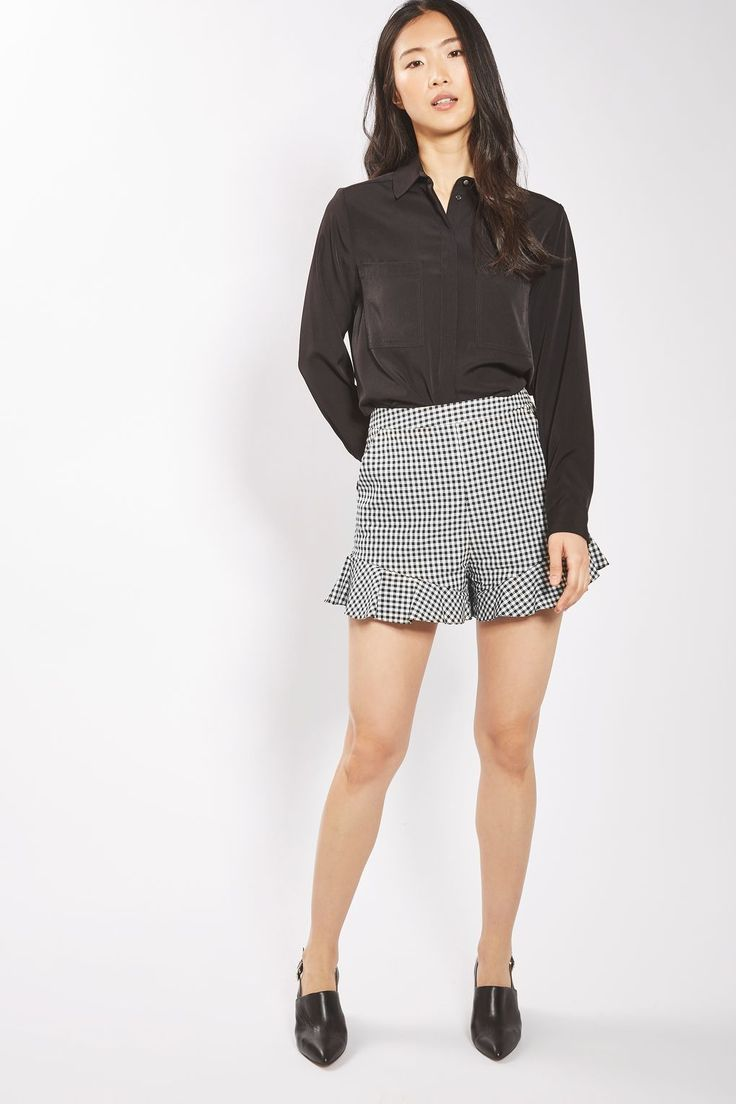 Gingham is the go-to print this season. Embrace the trend with these cute high-waisted shorts with frill detail to the hem for an added girlie feel.  Pair with a crisp black shirt to keep the look chic.