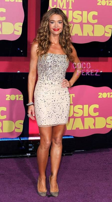 Denise Richards  At 2012 CMT Music Awards.(Early Life): Born february 17,1971 in Downers Grove,Illinois,USA. Is an American actress.The daughter of Joni a coffee shop owner and Irv Richards a telephone engineer,she has one sister, Michelle.Denise Richards is of Welsh descent on her father's side and of Croatian descent on her mother's.