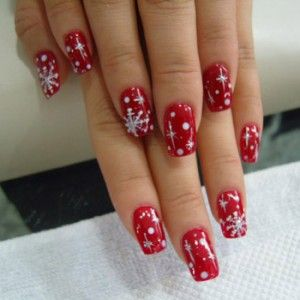 Red nails with snowflakes