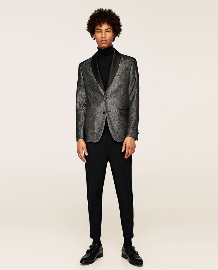 This Shiny Tuxedo Blazer with side flap pockets and smart satin detail includes buttoned cuffs, double vent in the back and lining with inner pockets. For that modern man look! Full details here http://www.fashion.ie/shiny-tuxedo-blazer/