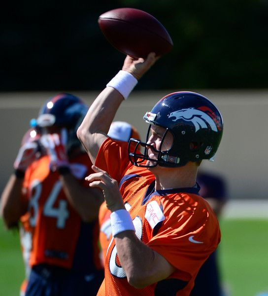 Description of . ENGLEWOOD, CO - SEPTEMBER 5: Quarterback Peyton Manning runs through a few passing drills. The Denver Broncos Football team practices at Dove Valley in Englewood in preparation for Sunday's season opener against the Indianapolis Colts. (Kathryn Scott Osler/The Denver Post)-- #ProFootballDenverBroncos
