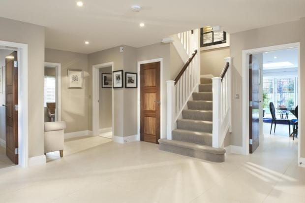 spotlights with neutral décor and grey carpet on stairwell