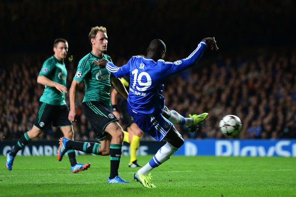 Demba Ba of Chelsea scores his team's third goal during the UEFA Champions League Group E match between Chelsea and FC Schalke 04 at Stamford Bridge on November 6, 2013 in London, England.