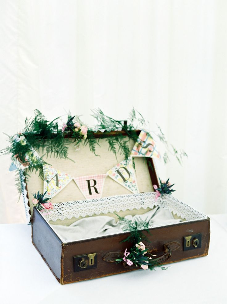 Vintage suitcase for wedding cards decorated with lace ribbon, bunting & vine florals - Image by Christian and Erica Photography - Dominique Sassi Holford Gown and Jimmy Choo Shoes for a classic wedding at Iscoyd Park with Grey Ted Baker Bridesmaid Dresses, Groomsmen in Navy Reiss Suits and pastel florals.