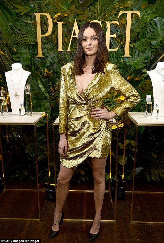 All that glitters: Australian modelNicole Trunfio dressed to impress in her metallic gold...
