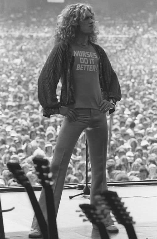 Robert Plant -  here he is with this t-shirt on again...  Robert knows what's up.  *grin* ~J.