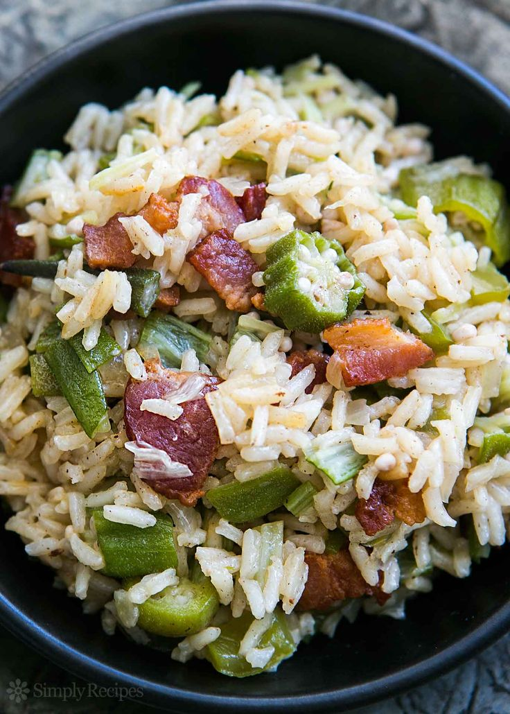 Okra with bacon, bell pepper, and rice! Delicious okra rice pilaf side dish. A South Carolina favorite. Easy! On SimplyRecipes.com