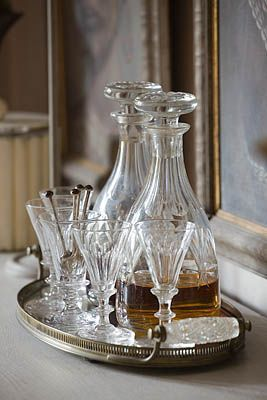 Decanters on a vintage silver plated tray. Photo by Clive Nichols. Repinned by www.silver-and-grey.com