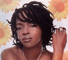 lauryn hill short locs with a flip and a side swept bang
