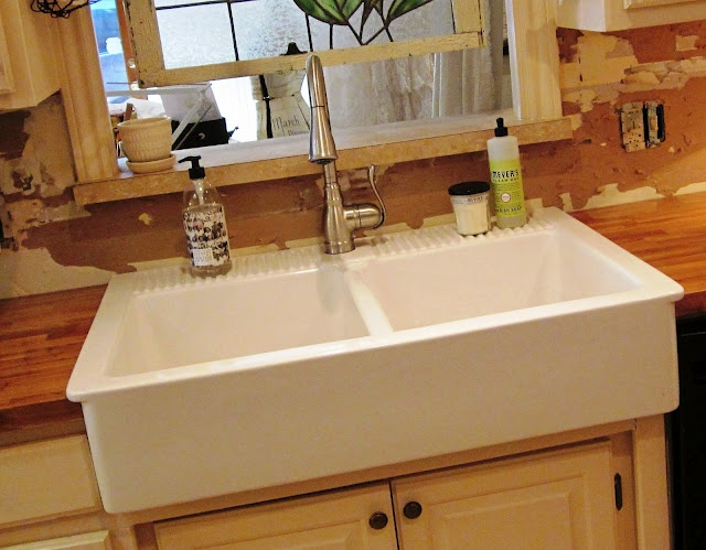 ikea farmhouse sink with butcherblock counters....