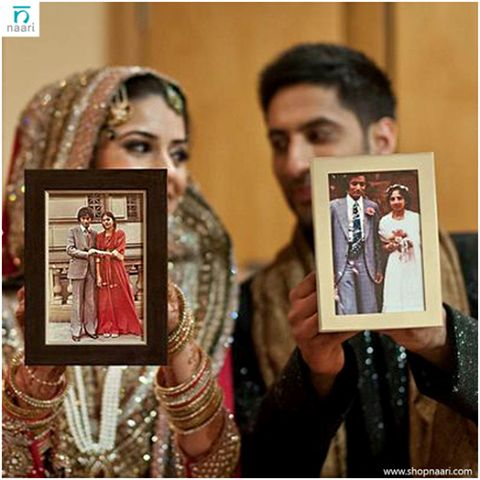 Your wedding day will probably be a day of mixed emotions for your parents as well as your in-laws. So how about adding more joy to this day by having a table filled with framed pictures from their own wedding days? And click a picture of yourself and the groom with their pictures. You could take it a step further and include photos of close relatives as well. #WeddingSurprise #WeddingLove #BeAllYouCanBe P.C.: Pinterest