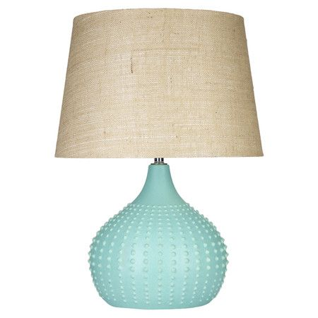 Table lamp with a linen shade and textured orb base in aqua