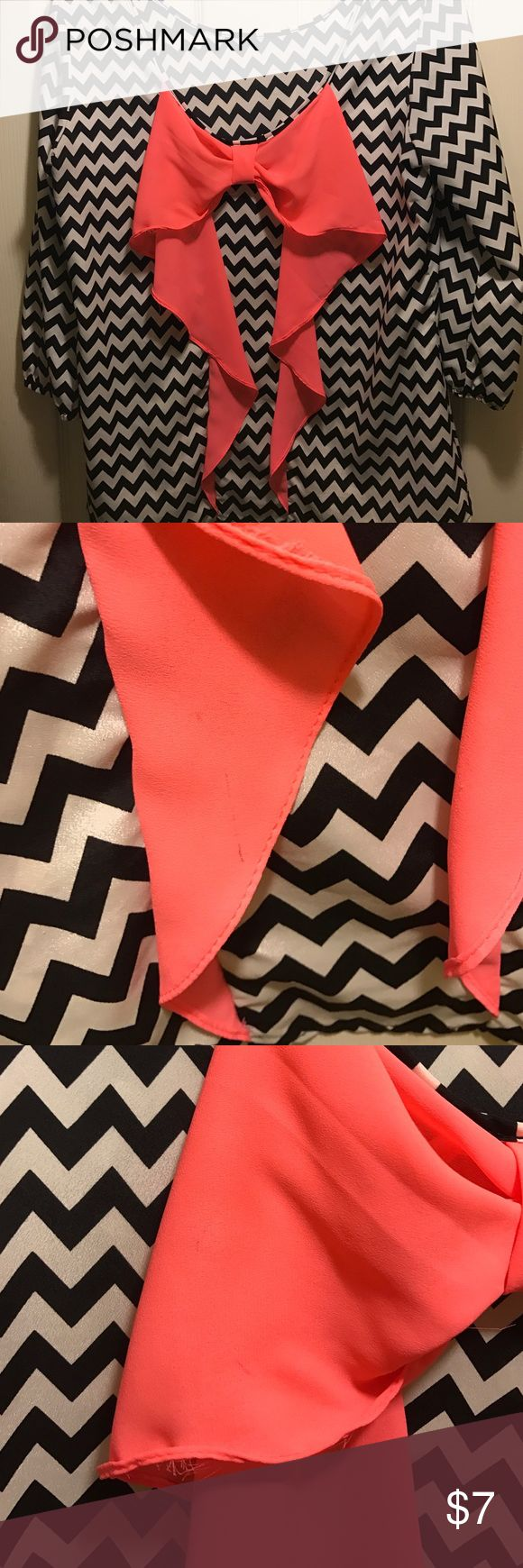 Black and white chevron shirt Chevron shirt with an orange bow, has a few pen marks on it, but can still be worn, bow goes on back Tops