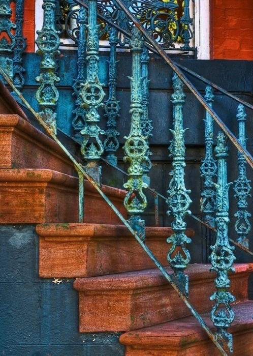 Beautiful blue wrought iron stair railings