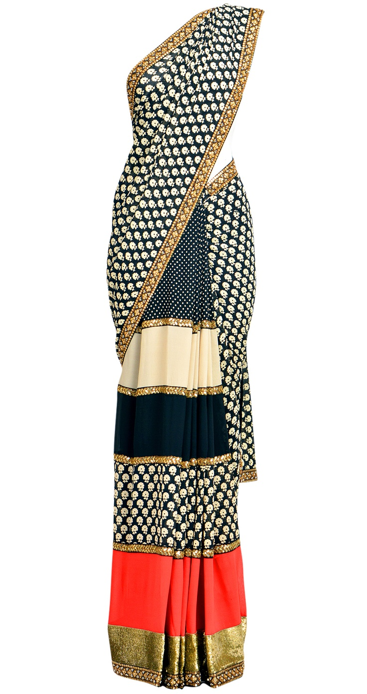 Black and beige georgette printed sari with black, beige and red striped pleates. It comes with a matching blouse piece.