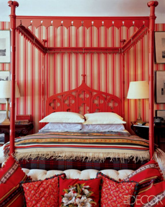 chinoiserie style bedroom with a persimmon orange canopy bed and stripped wallpaper - Orange Canopy Interior