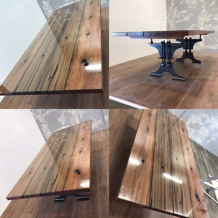 Reclaimed Narooma bridge timber dining table with industrial base & glass top.