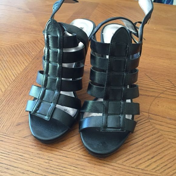 Mossimo Black Gladiator Heels Sz 5 1/2. Mossimo Black Gladiator Heels Sz 5 1/2.  Nails showing on heels.  Still comfortable and wearable.  Sold as is. Mossimo Supply Co Shoes Heels
