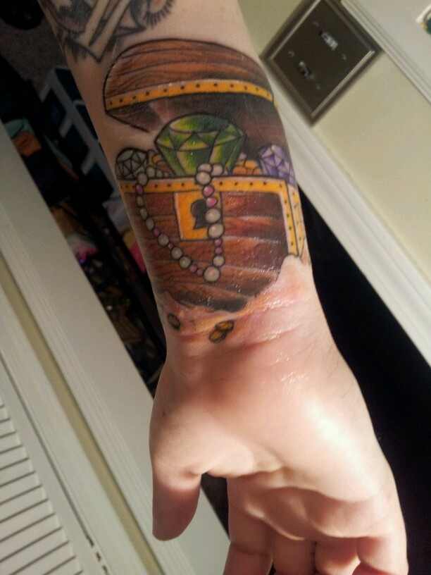 Treasure Chest tattoo with Childrens' birth stones as the jewels