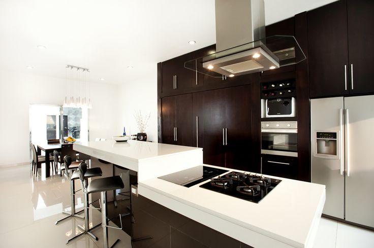 Blat kuchenny, wyspa kuchenna, elegancka kuchnia, nowoczesna kuchnia, meble kuchenne. Zobacz więcej na: https://www.homify.pl/katalogi-inspiracji/15070/blaty-kuchenne-jak-wybrac-ten-odpowiedni