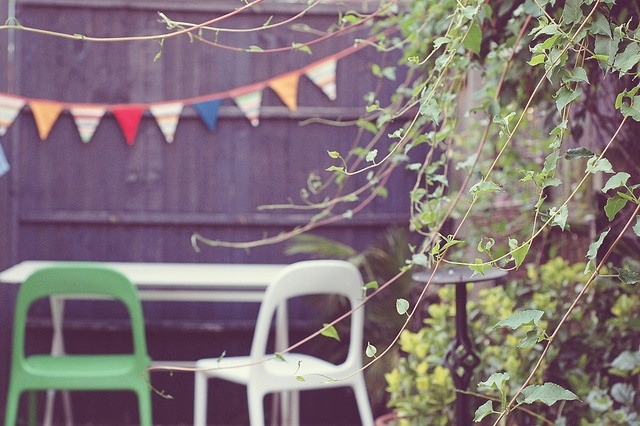 Our garden - I love the bright bunting (etsy) and (ikea) chairs. Makes up for the lack of sun.