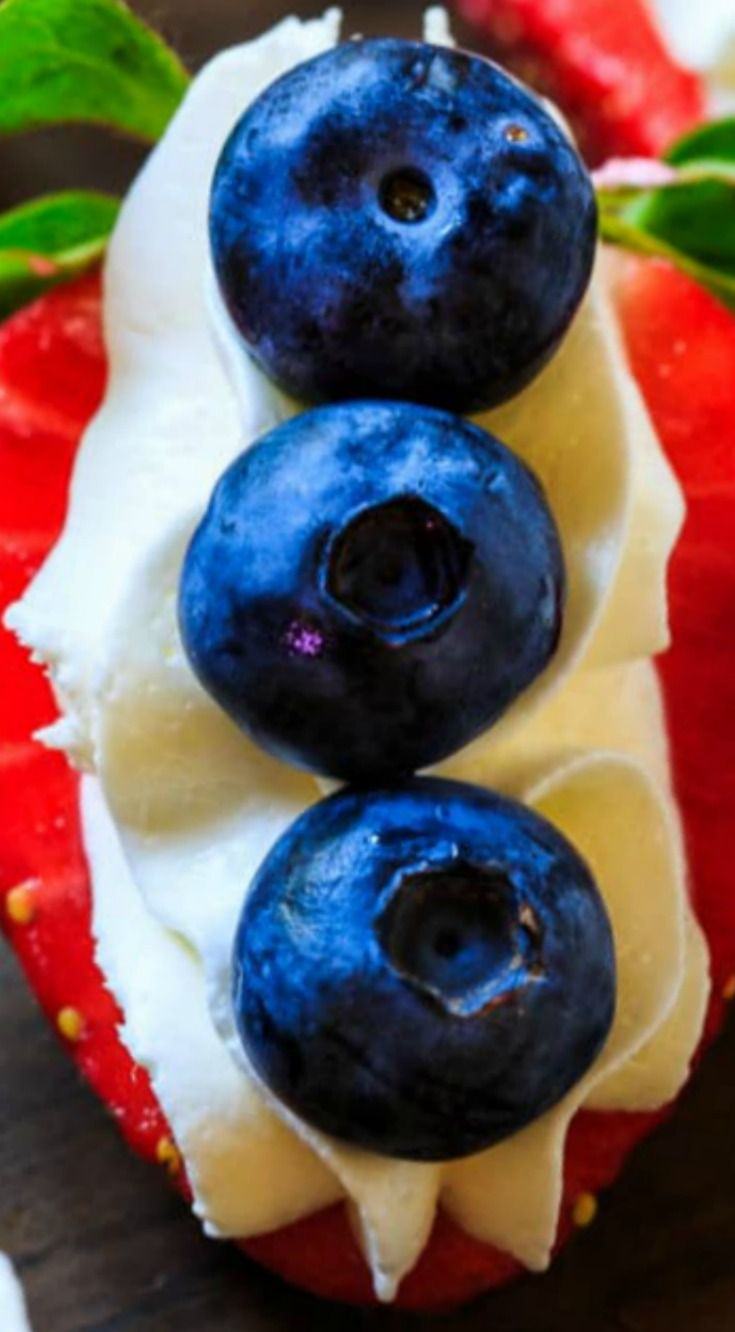 Red, White, and Blue Cheesecake Strawberries ~ Festive and simple to make... The perfect bite-sized finger food for your Fourth of July Party.