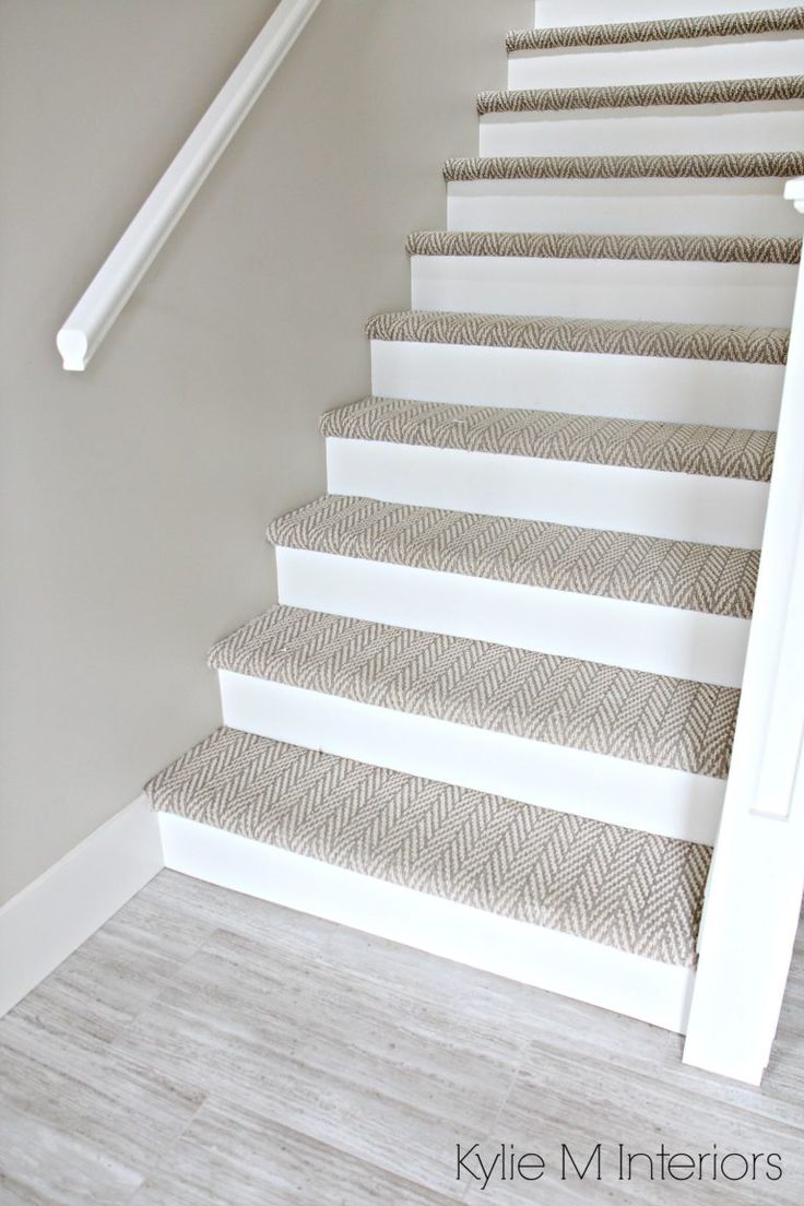 Stairs with carpet herringbone treads and painted white risers, looks like a runner. Benjamin Moore Edgecomb Gray on stairwell wall. Kylie M Interiors E-Design