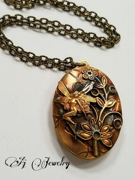 Check out this item in my Etsy shop https://www.etsy.com/listing/479990688/fairy-oval-locket-necklace #ajjewelry #jewelry # locket #handmade