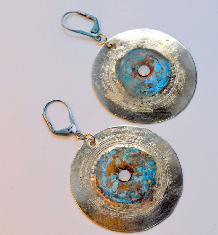 """Brass Patina Medallion Earrings with bold blue & rust patina on textured brass rounds by Bandana Girl Rounds are 1.5"""" wide on ant silver finish leverback earwires ( if you prefer solid copper or brass earwires, please leave message on order. Opal Crystal in center...stunning and sealed for longevity! _____________________________________________"""