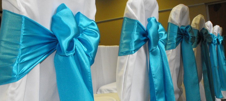 Turquoise Satin Bows on White Chair Covers