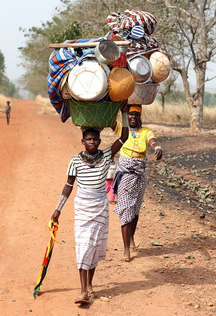 Fulani women going to market. The Fulani people of West Africa are the largest nomadic group in the world. As a group they contain a vast array of diverse people who were conquered and became a part of the Fulani through the spread of Islam. Fulani people descended from nomads from both North Africa and sub-Saharan Africa.