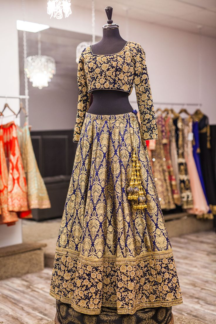 Here's a look at this breathtaking blue lehenga! It has asymmetrical jaal embroidery using dori and metal sequins. The asymmetrical embroidery gives this piece a very unique and versatile look. We love the contrast between the blouse and lehenga that give this such a regal and royal touch.