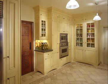 Buttery yellow cabinets with green granite counters. Lovely style. Mahogany door. Jamie Herzlinger - mediterranean - Kitchen -