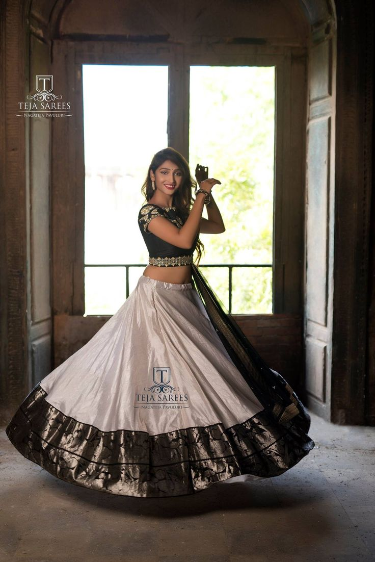 Sampradaya 009Available The Joy of Dressing is an Art !!! Beautiful silver color lehenga and black color blouse with dupatta.For orders/queries Call/ whats app  on8341382382 orMail  tejasarees@yahoo.com. 20 January 2018