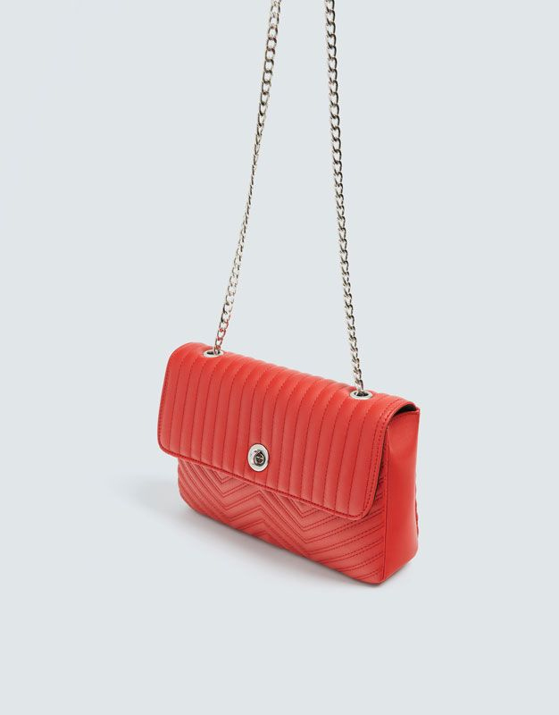 Photo of Quilted red diagonal strap bag