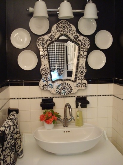 Get creative using everyday items, like a collection of porcelain plates from HomeGoods as art, in not-so-everyday places. These plates help make this HomeGoods vintage-inspired mirror even more of a focal point in the powder room.