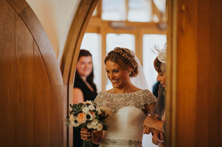 Beautiful bride with braided hair in her stunning @justinalexander gown. Photo by Benjamin Stuart Photography #weddingphotography #bride #braidedhair #justinalexander #weddingbouquet #weddingday