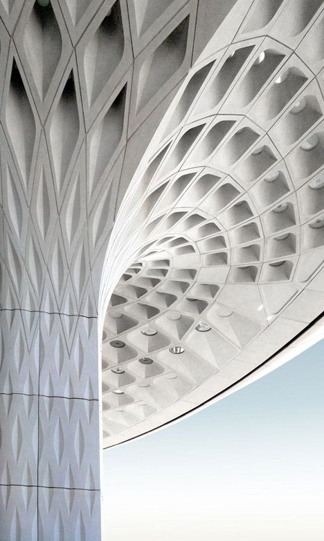 Mumbai airport terminal with coffered concrete canopy.