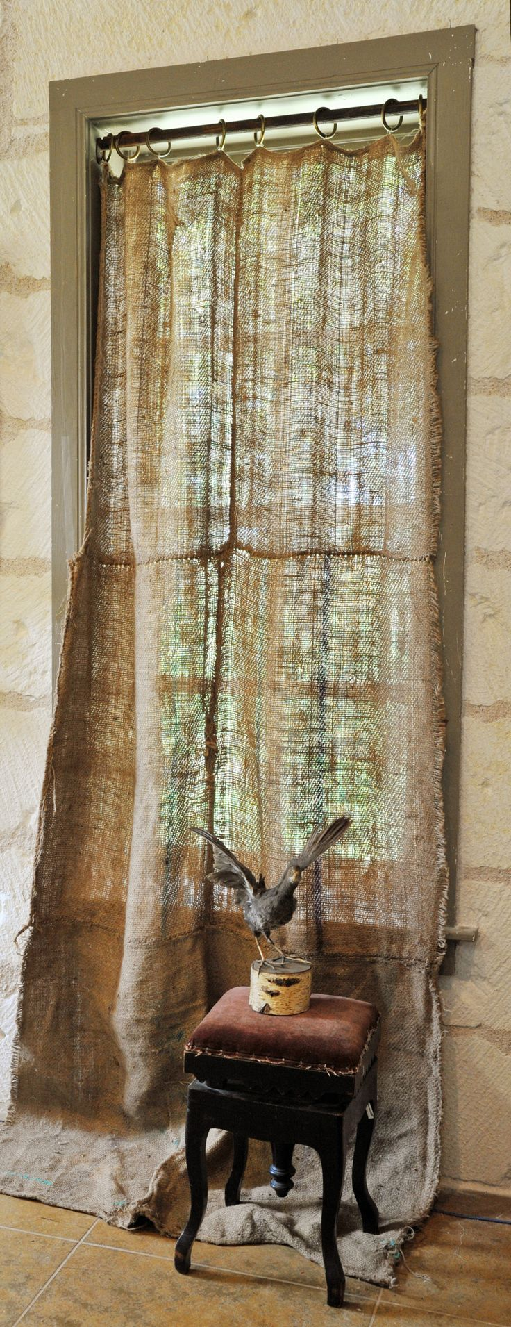 Burlap curtains... i know not everyone would go for this but i LOVE it. I even love the distressed trim around the window.