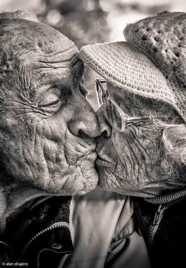 This makes me smile - so precious. :-) Love over time, old faces, wrinckles, lines of life, sharing a life, powerful image, strong, intense, portrait, photo b/w.