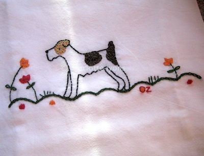 Love this embroidered dog by Charlotte Lyons