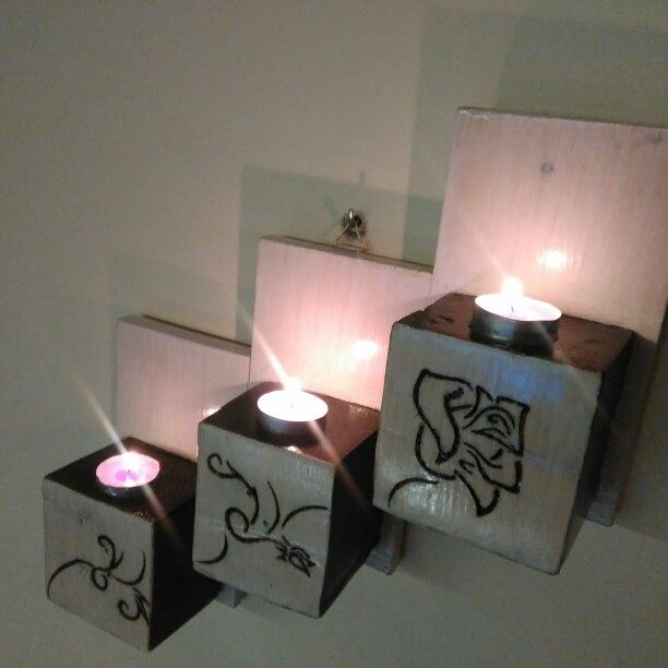 Candle holder made from wood pallet with burn rose.