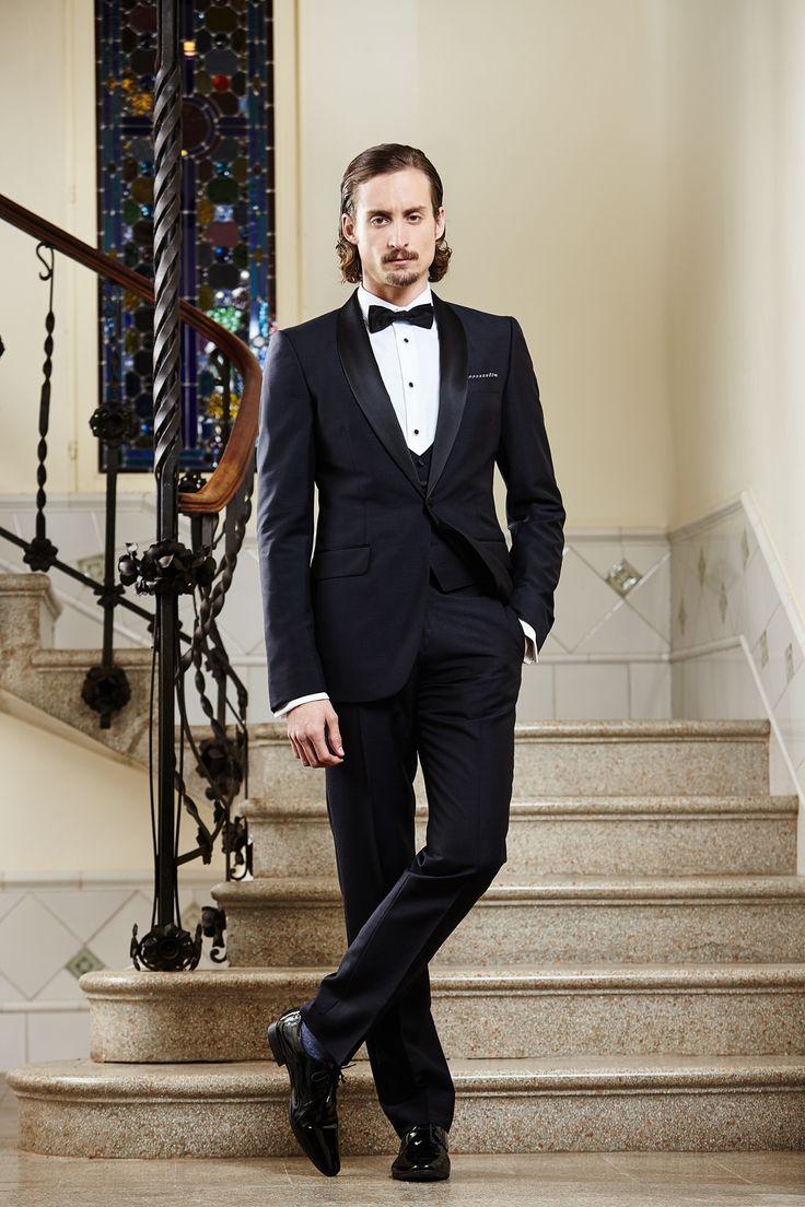 Men's classic black tailored wedding suit.