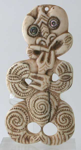 New Zealand | Maori Hei Tiki pendant | Whale bone | 19th - 20th century