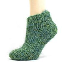 """EASIEST SOCK EVER. Two needles. I did 22 stitches. K1p1 continously for 21"""" The Diagram on the seams is very simple as well."""