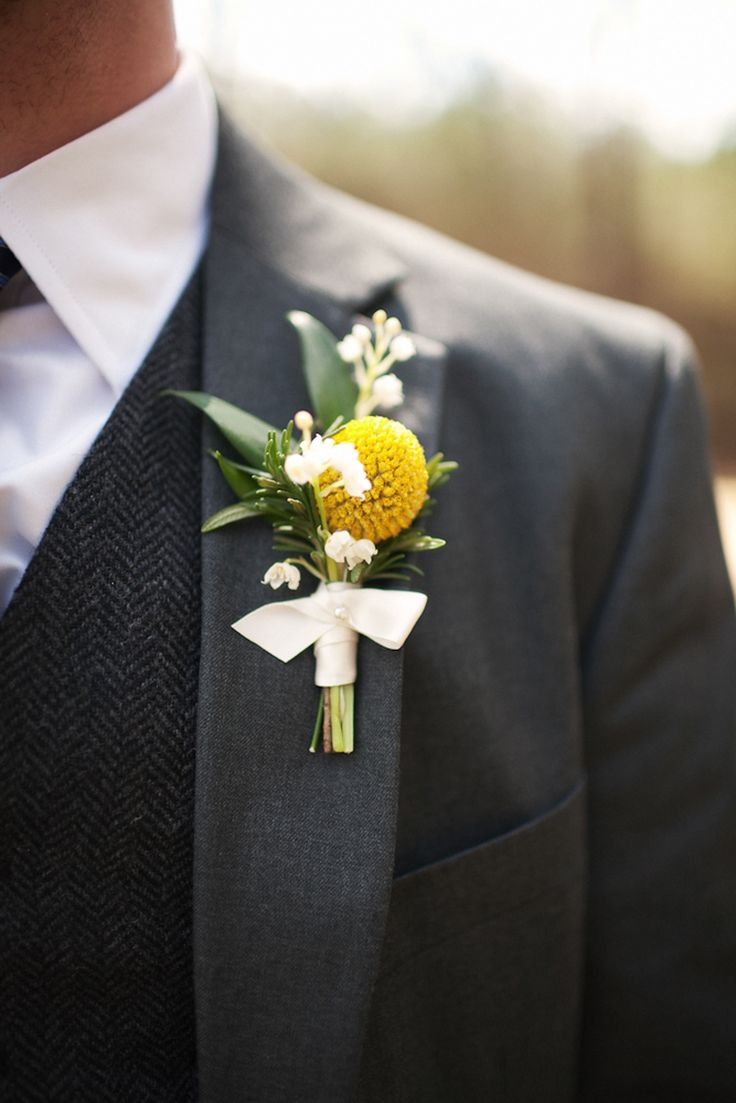 Charcoal grey suit (and awesome wool vest) with touch of yellow in the boutonniere -- Perfect for a fall wedding!