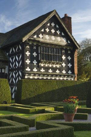 The garden front of Little Moreton Hall, the Tudor, timber-framed manor house in Cheshire