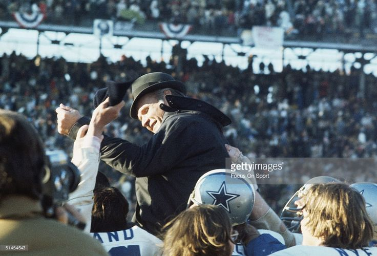 Tom Landry, head coach of the Dallas Cowboys, is carried off the field by his team after winning Super Bowl VI against the Miami Dolphins at Tulane Stadium in New Orleans, Lousiana on January 16, 1972. The Cowboys defeated the Dolphins 22-3.